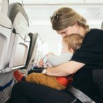 Mom and baby seated on an airplane